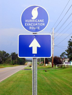 a hurricane evacuation sign - know your evacution routes beforehand